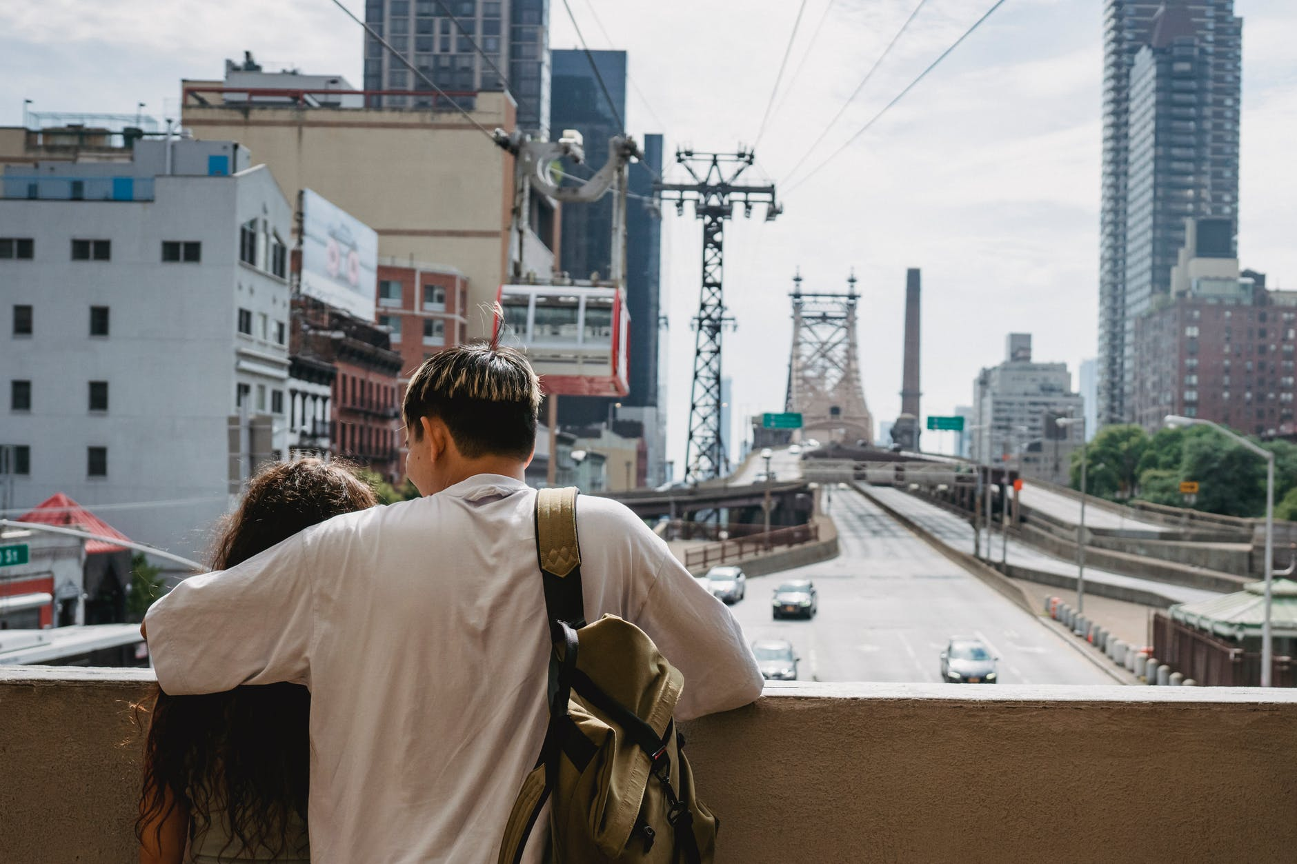 unrecognizable couple hugging and enjoying new york city views